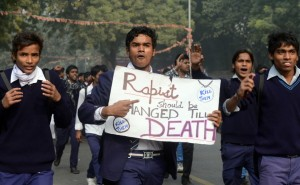 Demonstrating-Indian-school-students-hold-placards-as-they-shout-anti-government-slogans-during-a-protest-calling-for-better-safety-for-women-following-the-rape-of-a-student-in-New-Delhi-on-December-24-2012.-RaveendranA